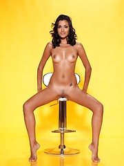 Tanned babe Belinda A shows her pussy
