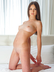 Analisa makes an hot debut, posing sweetly as she fulfills every man's desire of finding a beautiful woman, naked on top of their otherwise vacan