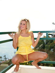 Charlie Lynn hanging on the terrace in her yellow dress flashing her sweet, round boobies