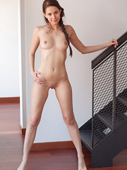 Vanessa Angel shows off her tight, toned body posing naked on the cold steel staircase.